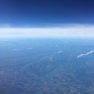 A view of water and land from the airplane.