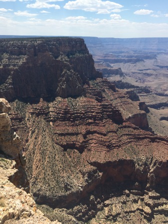 A massive rock structure with countless ridges stands before the Canyon