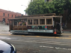A trolley going across Powell and Hyde Street in San Francisco