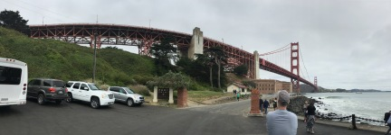 A panoramic of the beautiful Golden Gate Bridge against a cloudy sky.