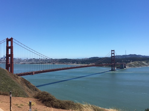 The Golden Gate Bridge stand tall and grand against a crystal clear sky.