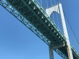 A picture taken directly underneath the Newport Bridge.